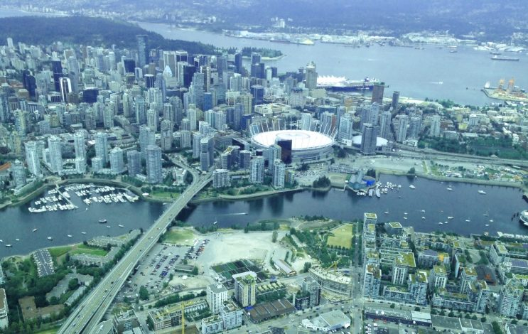 Aerial view of the Olympic Village site and downtown core shows the barren site of the long-promised Olympic Village elementary school.